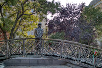 The Imre Nagy statue on a bronze walking bridge in Budapest, Hungary.