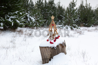 Christmas tree and Christmas decorations in snowy landscape