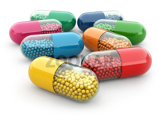 Pills and drugs on white isolated bacground. Medical concept.