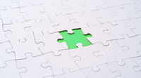 Empty white jigsaw puzzle with  missing piece