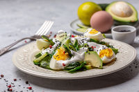 Healthy salad of green vegetables and eggs.