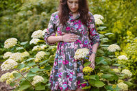 Beautiful pregnant woman in the garden