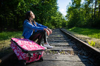 During long journeys on foot along the tracks, the teenager decided to sit down and rest directly on the railway track.