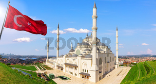Big Camlica Mosque and the Turkish flag, Istanbul, Turkey