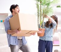 Young family moving in to new apartment after paying off mortgag