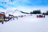 Saalbach, Austria, people snowboarding and skiing