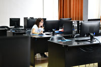 one student in computers classroom
