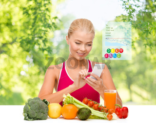 woman with vegetables pointing at smartphone