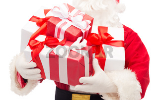 close up of santa claus with gift boxes