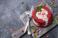 Red velvet pancakes with cream cheese sauce.