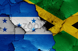 flags of Honduras and Jamaica painted on cracked wall