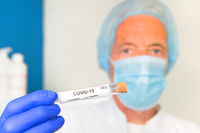 Doctor with covid-19 test