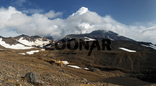 Volcanic landscape of Kamchatka Peninsula: panoramic view of active Mutnovsky Volcano