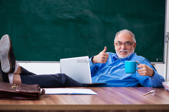 Old male teacher in tele-education concept