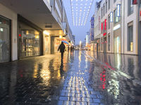 Pedestrian Shopping street Bahnhofstraße on a rainy evening
