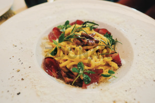 Italian high-end cuisine and fine dining, delicious pasta on a plate in a luxury restaurant in Milan, Italy