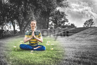 Young man meditating outdoors in the park, sitting with eyes closed and his hands together.enjoying nature, yoga and meditation concept. spiritual practices. art photo. zen