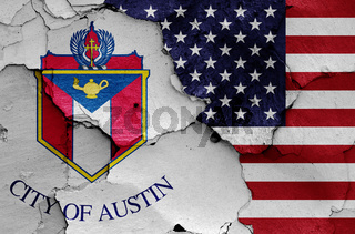 flags of Austin and USA painted on cracked wall