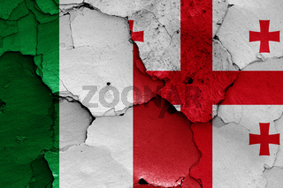 flags of Italy and Georgia painted on cracked wall