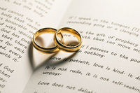 Golden wedding rings on bible book
