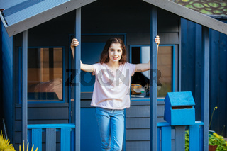 Girl Posing Outdoors in a Cubby House