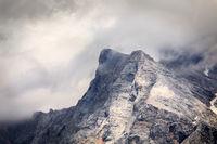 mountain rocky peak in clouds