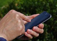Hand am Smartphone