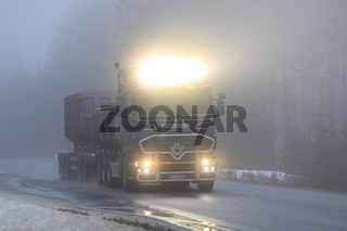 Scania Truck Headlights on Foggy Road