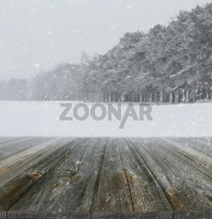 Winter background with wood planks in forefront