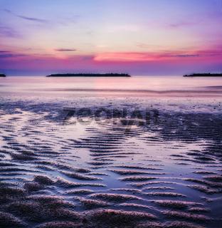 Sunrise by the sea in an italian beach