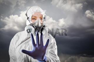 Chinese Woman Wearing Hazmat Suit, Protective Gas Mask and Goggles With Stormy Background