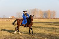 Hungarian csikos horseman in traditional folk costume