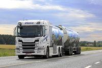 White New Milk Truck on Road