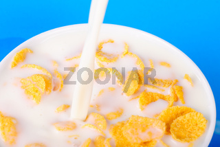 Cornflakes and pouring milk