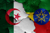 flags of Algeria and Ethiopia painted on cracked wall