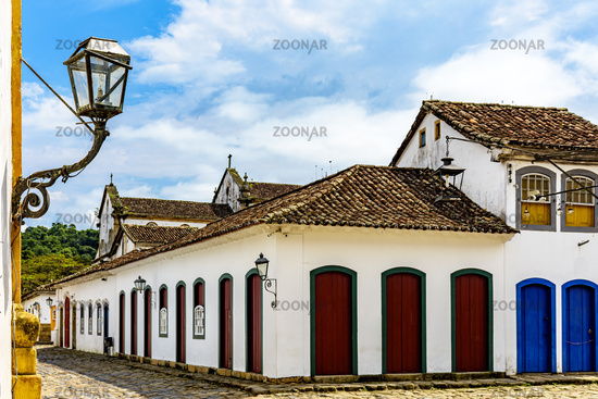 Cobblestone streets and house facades with old colonial-style lanterns
