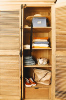 Casual clothes, shoes, bag and jewelry in a wardrobe in retro style