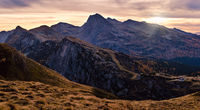 Evening dusk autumn Dolomites panoramic Rolle Pass view, Trento, Italy.