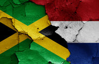 flags of Jamaica and Netherlands painted on cracked wall