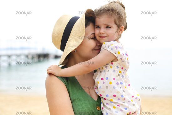 Mother and baby daughter at the beach