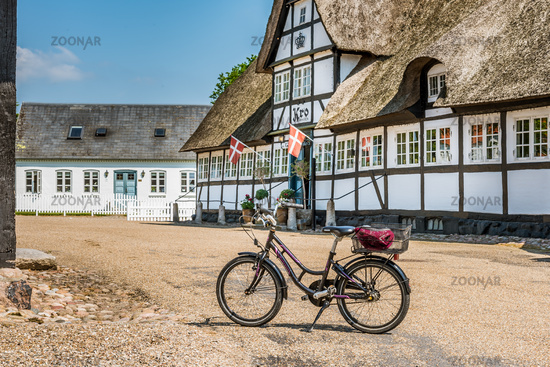 a bike in front of an idyllic half-timbered tavern in Denmark