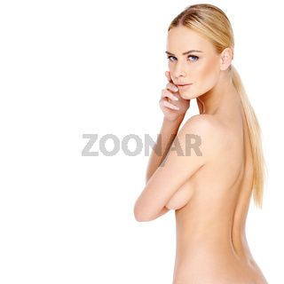 Pretty young blond woman posing topless