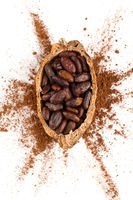 Fresh roasted cocoa beans on white background top view.