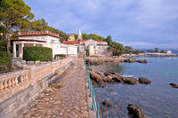 Adriatic town of Opatija watefront walkway and church view