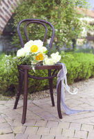 Vintage chair with flowers in garden