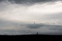 Silhouette of a high seat in thick clouds