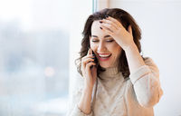 Happy brunette woman using mobile phone