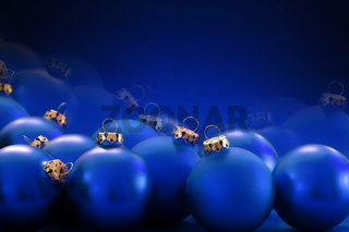 blue christmas baubles on blurred blue background, copy space
