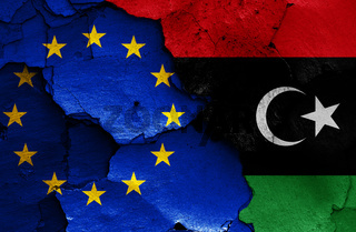 flags of EU and Libya painted on cracked wall