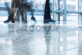 Blurred motion of people walking